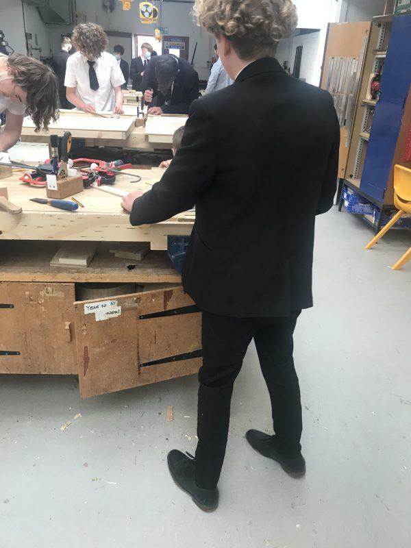 Peter making a door frame